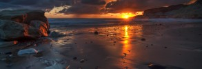 sunset_rocks_beach_sand_wet_twilight_tide_48097_2560x1600